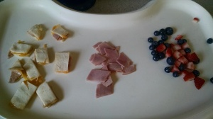 Cheese quesadila, ham slices and mixed berries
